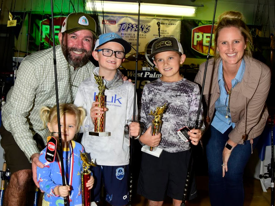 Family with fishing trophies