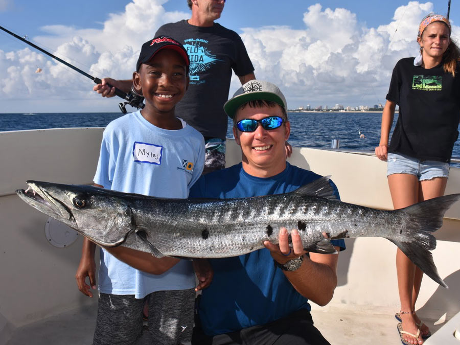 myles with big barracuda