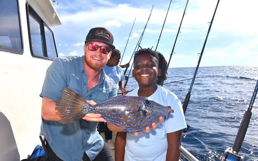 young angler with parrot fish