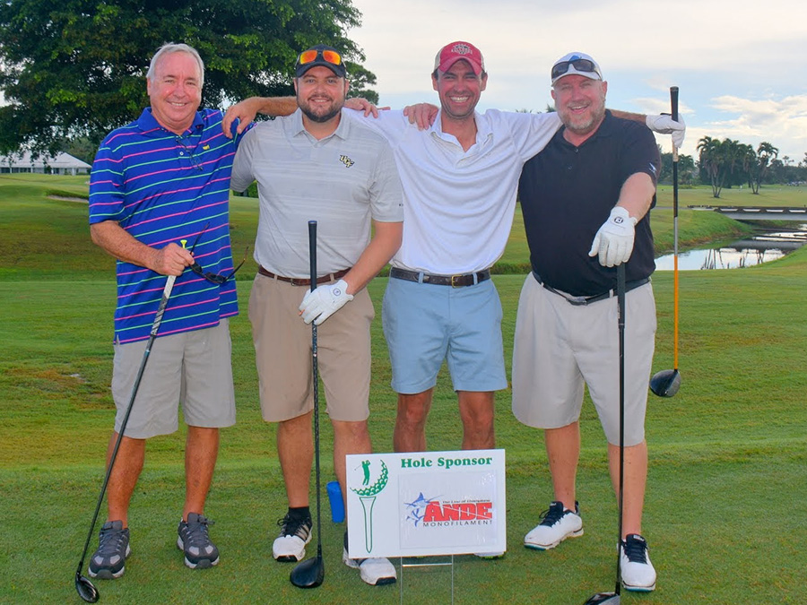 golfers at charity tournament